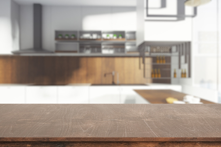 Clean wooden table on blurry kitchen background. 3D Rendering 写真素材