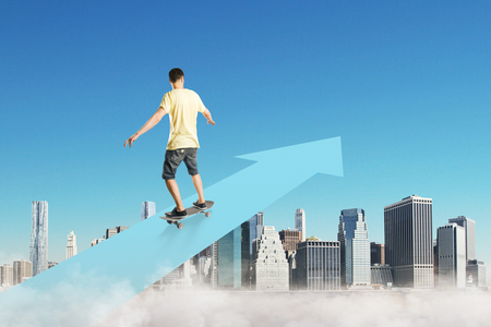 Young man on skateboard on abstract arrow. Blue city sky background. Career and up concept Banco de Imagens