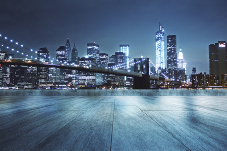 Concrete rooftop with beautiful night city view background