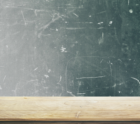 Blank wooden desktop with chalkboard in the background. School concept. 3D Rendering