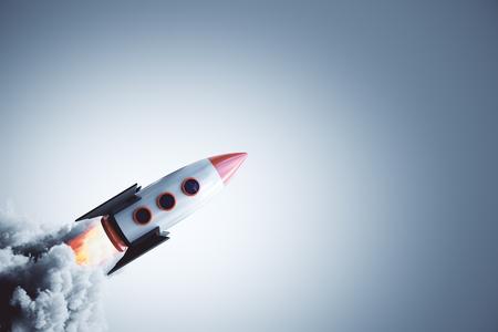 Lancement de fusée sur fond gris. Concept de démarrage et d'entrepreneuriat. Rendu 3D