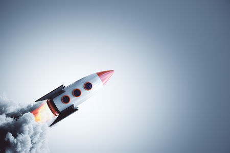Launching rocket on gray background. Startup and entrepreneurship concept. 3D Rendering Banco de Imagens