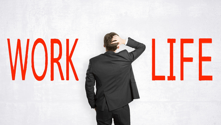Businessman choosing between work and life on concrete background. Lifestyle and think concept Banque d'images - 106747242