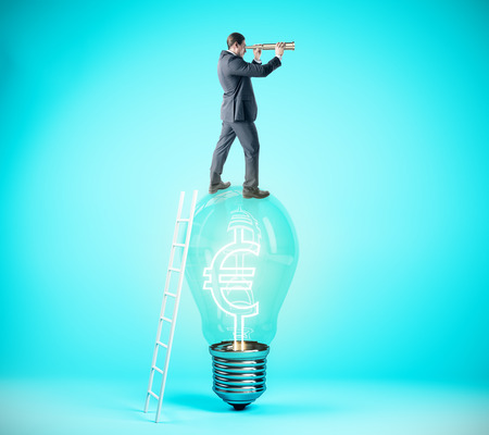 Businessman using binoculars while standing on lamp with euro sign on blue background. Vision, finance and idea concept. 3D Rendering Zdjęcie Seryjne