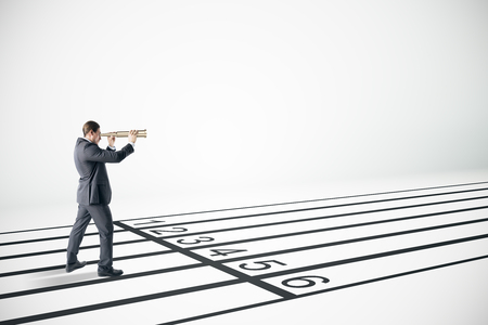 Businessman looking into the distance with binoculars on race tracks. Vision and competition concept