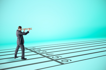 Businessman looking into the distance with binoculars on race tracks. Vision, research and competition concept