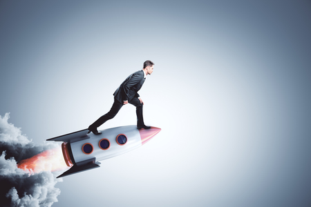 Businessman on creative launching rocket. Startup and career concept. 3D Rendering