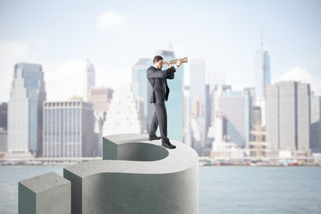 Businessman using binoculars to looking into the distance while standing on question mark on city background. Confusion and vision concept. 3D Rendering 版權商用圖片