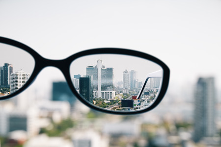 Close up of spectacles on blurry city background. Clean vision concept. 3D Rendering