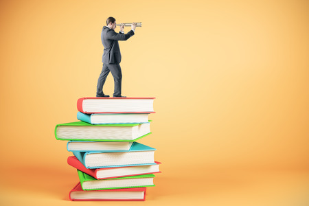 Businessman looking into the distance while standing on book stack. Education, research and finance concept. 3D Rendering