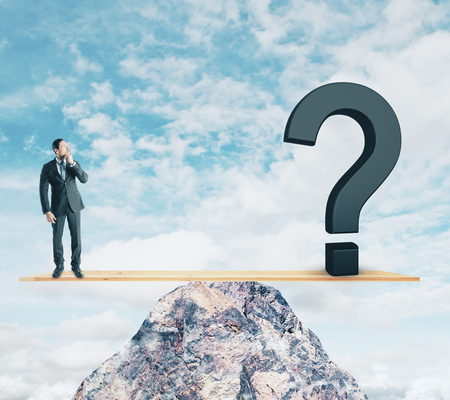 Businessman on abstract mountain scales with question mark. Sky background. Confusion and risk concept Imagens