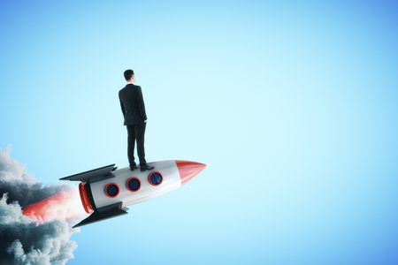 Businessman on creative launching rocket. Startup and research concept. 写真素材 - 107404827