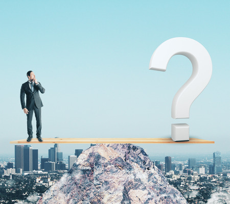 Businessman on abstract mountain scales with question mark. Sky background. Confusion and balance concept Reklamní fotografie - 107404875