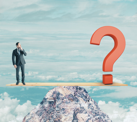 Businessman on abstract mountain scales with question mark. Sky background. Confusion and challenge concept