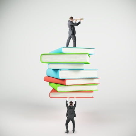 Businessman holding colorful books stack on light background. Education and research concept