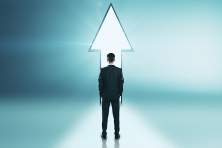 Businessman standing at arrow exit. Possibility and growth concept Stok Fotoğraf