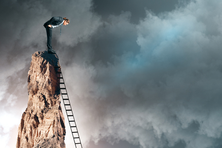 Businessman on cliff with ladder on sky background. Research and risk concept