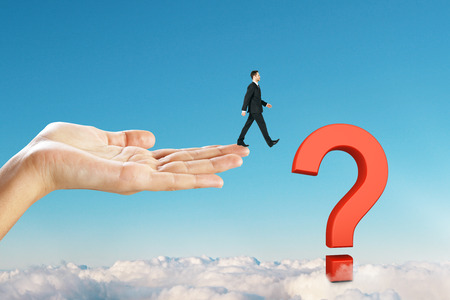 Businessmen walking towards question mark on blue sky background. Confusion and ask concept
