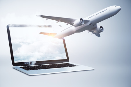 Airplane flying out of laptop screen with sky. Online booking and vacation concept. 3D Rendering Stock Photo