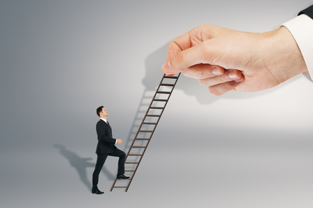 Businessman with ladder on gray background. Career development and promotion concept Archivio Fotografico - 108172088