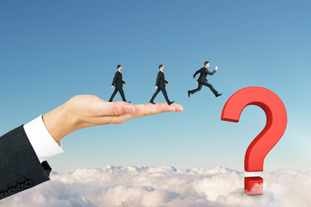 Businessmen walking towards question mark on blue sky background. Confusion and teamwork concept