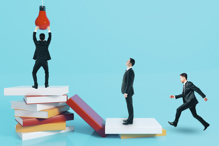Businessmen with abstract books and lamp. Education, idea and teamwork concept. 3D Rendering