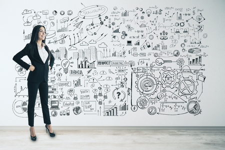 Management and finance concept. Attractive young european businesswoman with business sketch on concrete wall background