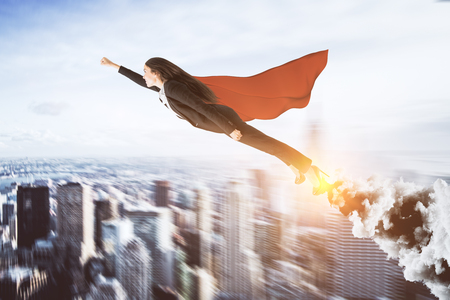 Creative super hero businesswoman on blurry city background. Leadership and confidence concept Stock Photo