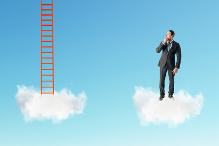 Businessman with cloud ladder on sky background. Dream and success concept