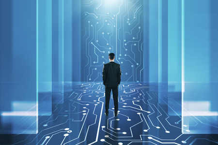 Back view of young businessman standing in abstract circuit interior. Technology and AI concept. 3D Rendering Stock Photo