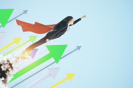 Super woman launching on creative blue background with arrows. Leadership and financial growth concept