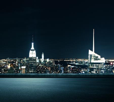 Creative illuminated night New York city background. Urban concept
