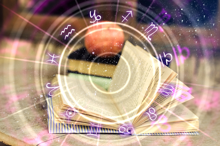 Close up of abstract book with zodiac wheel. Magic and astrology concept. Double exposure Stok Fotoğraf