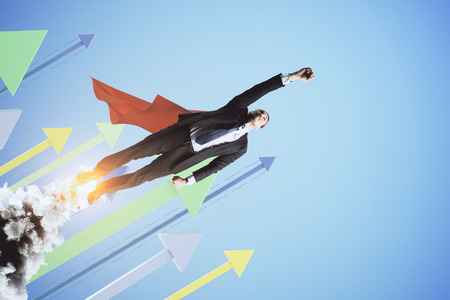 Super man launching on creative blue background with arrows. Leadership and financial growth concept