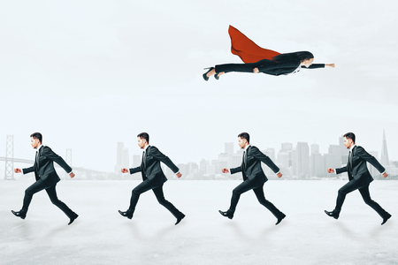 Businesswoman flying over row of businessmen on city background. Different direction and leadership concept 스톡 콘텐츠