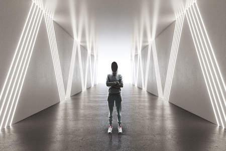 Young female hacker in futuristic corridor. Malware and hacking concept. 3D Rendering Stock Photo