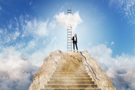 Young businesswoman climbing stairs on beautiful sky background with clouds. Career development and success concept Stockfoto
