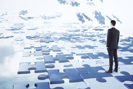 Challenge and choice concept. Businessman on abstract cloudy sky background with jigsaw pieces. 3D Rendering