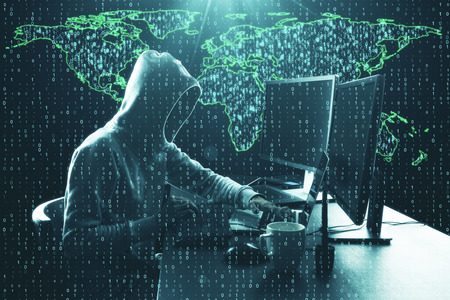 Hacker using computer at desk with map and binary code. Computing and phishing concept. Double exposure Stock Photo