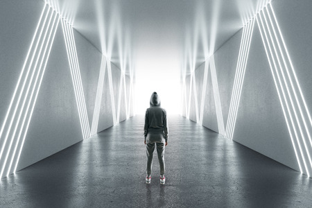 Young female hacker in futuristic hallway. Malware and hacking concept. 3D Rendering