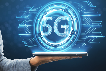 Close up of hand holding tablet with glowing 5G icon on blurry blue background. Internet speed and connection concept. 3D Rendering Stok Fotoğraf