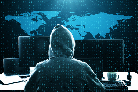 Hacker using computer at desk with map and binary code. Computing and malware concept. Double exposure