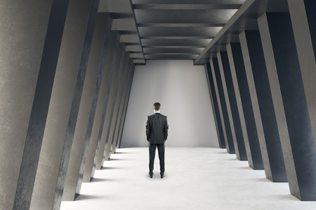 Back view of young businessman in modern concrete hall interior. 3D Rendering 스톡 콘텐츠