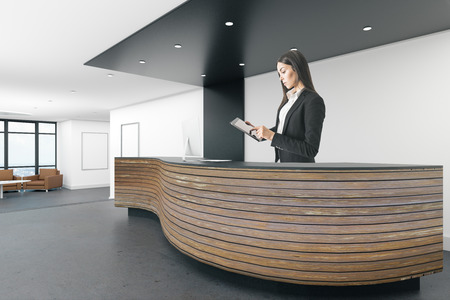 Attractive young european woman standing at modern reception desk in office interior. 3D Rendering