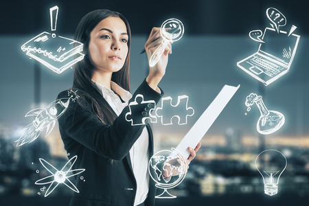 Success and teamwork concept. Attractive european businesswoman drawing creative glowing sketch on blurry night city background