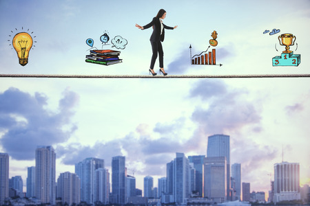 Side view of young businesswoman balancing on tightrope with business sketch on city background. Equilibrium and leadership concept