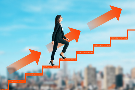Side view of young businesswoman climbing abstract drawn ladder on blurry city sky background. Career development and ascend concept