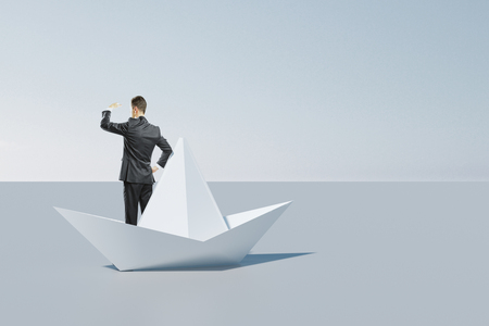 Businessman looking into the distance from abstract origami boat. Leadership and vision concept. 3D Rendering