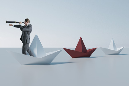 Businessman looking into the distance from abstract origami boat. Leadership and future concept. 3D Rendering 版權商用圖片