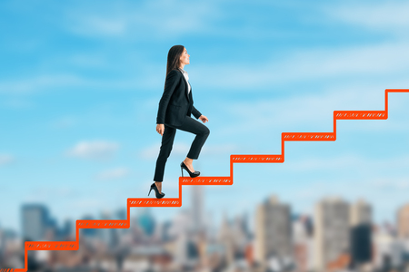 Side view of young businesswoman climbing abstract drawn ladder on blurry city sky background. Career development and promotion concept Stock Photo